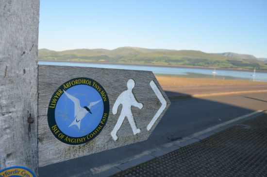 The signs marking the coastal path.