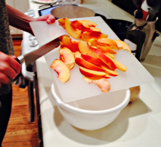 Slice the peaches and chop the onions. Kathleen was the chopping master.
