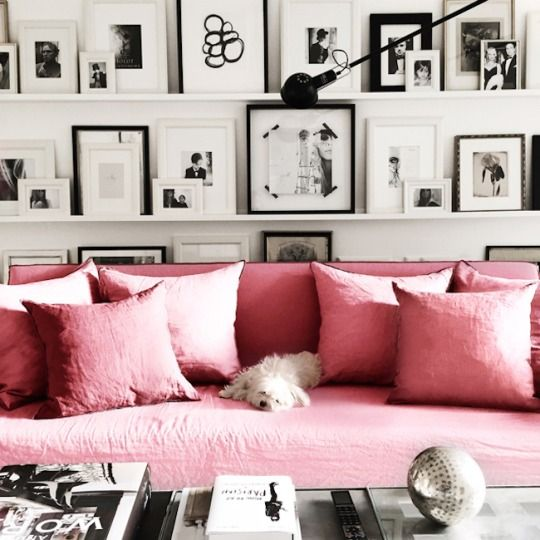Pink sofa with a black & white gallery wall