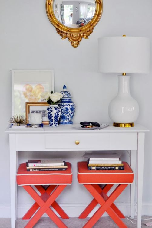 Coral ottomans in the entryway