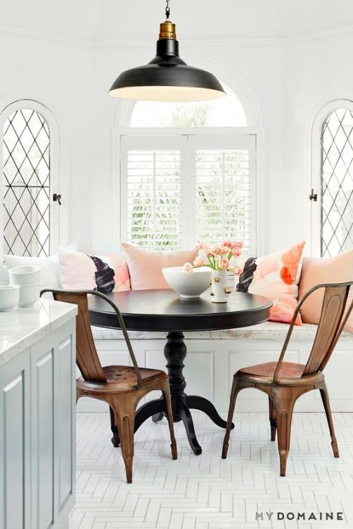 Coral pillows in the dining nook