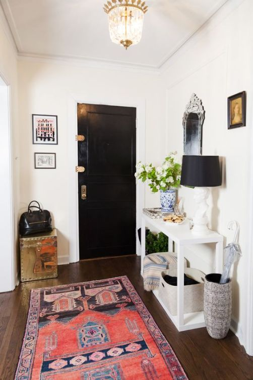 Coral rug in the entryway
